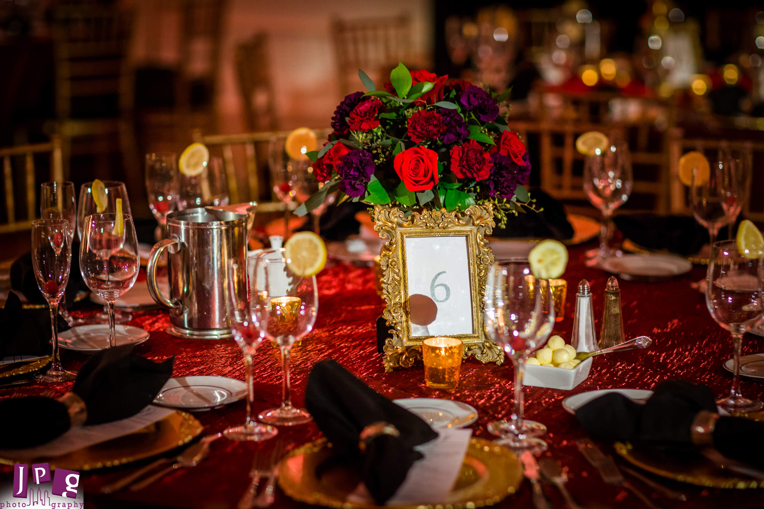 centerpiece low red flowers with red linen gold table number ...